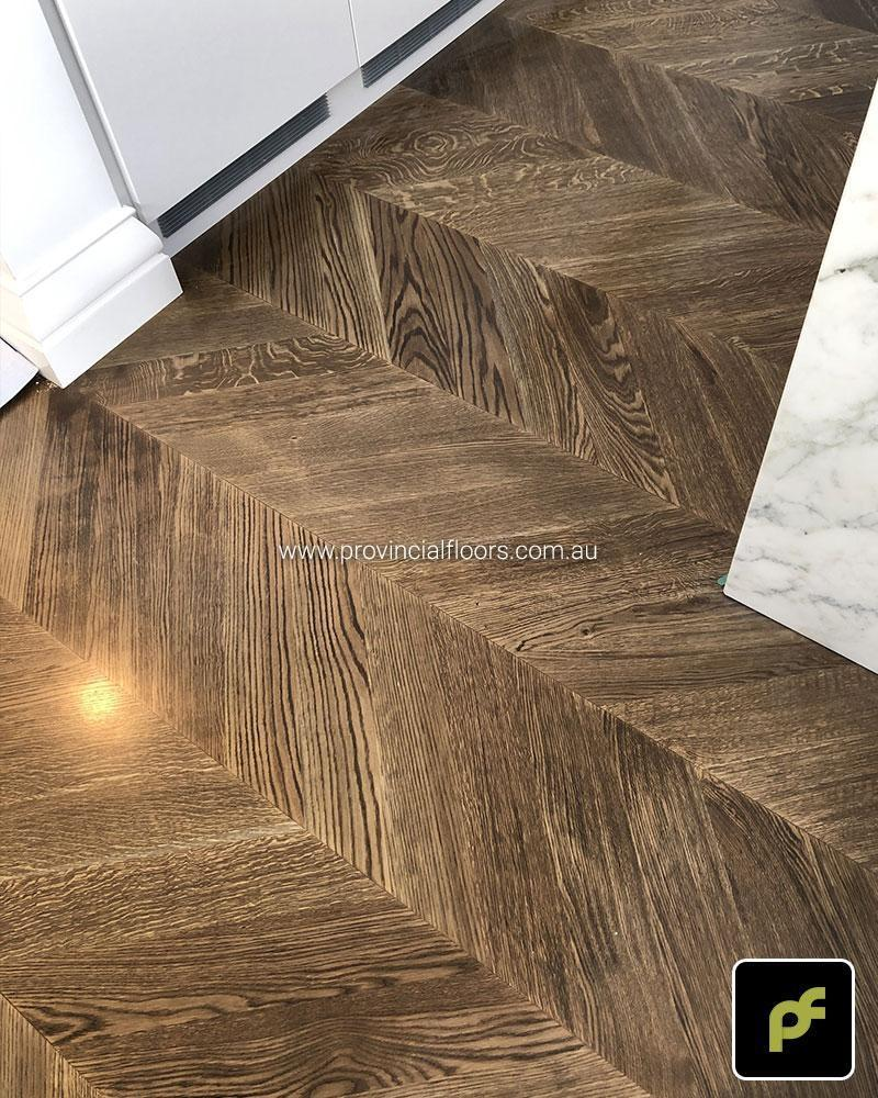 European Oak Chevron Parquetry with a Stained Water-Based Polyurethane Finish. Satin in sheen.