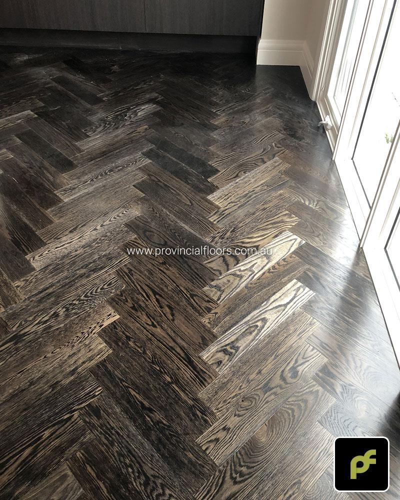 European Oak Herringbone Parquetry with a Stained Water-Based Polyurethane Finish. Satin in sheen.