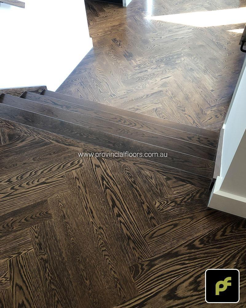 American Oak Herringbone Parquetry with a Stained Water-Based Polyurethane Finish. Satin in sheen.
