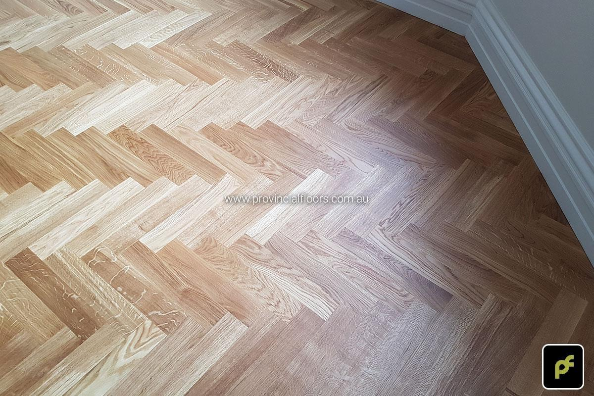 European Oak Herringbone Parquetry with a Jarrah border design feature. With a Natural Coloured Oil/Wax Finish. Matte in sheen and easily repairable.