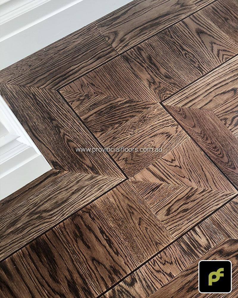 American Oak hand-made Monticello Paneled Parquetry with circumnavigating border designs. With a Stained Water-Based Polyurethane Finish. Satin in sheen.
